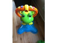 Baby frog bouncer toy