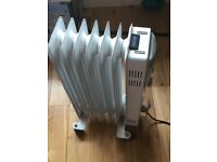 Oil filled electric heater for sale