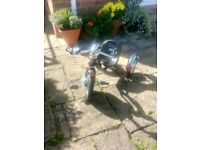 Chrome wood and metal frame lightly used Tricycle. Pet free home and in very good condition. .