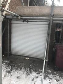 White electric roller garage door
