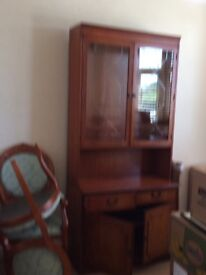 Lovely yew finish display cabinet with storage by Lexterten