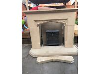 Fire surround, hearth and fire