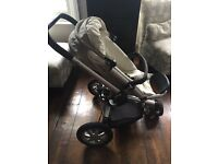 Quinny Stroller in Beige with foot muff and rain cover - excellent condition