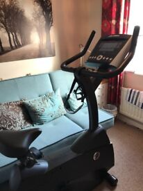 Life Fitness C1 lifecycle upright exercise bike with GO console.