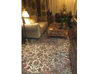 A huge hand knotted Persian oriental rug carpet. Stunning work, must have taken ages to make.