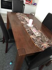 Dark brown oak table and 4 brown chairs
