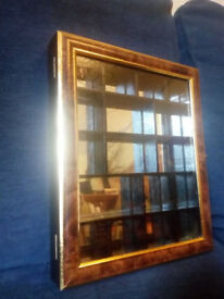 Display Cabinet - two toned wood mirrored display with cubic spaces and door clasp £20 ono
