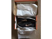 Brand new size 5 Nike black and bronze trainers