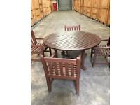 Solid wood garden table and 8 chairs