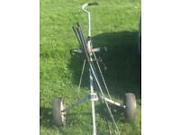 Golf trolley and spare clubs