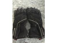 Two pairs of motorcycle gloves. One small, one XL. Both waterproof. £20