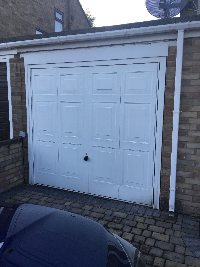 Up and over garage door - Electric Up And Over Garage Door White Very Good Condition Very Smal Dent