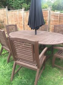 6 seater table and chairs and unbella