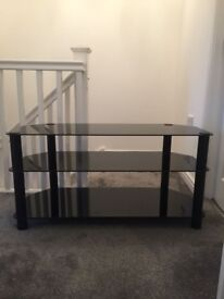 Black glass tv stand for sale in good condition