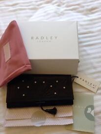 Brand new Radley black leather clutch bag in box