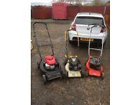 3 petrol lawnmowers