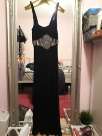 Long black jersey dress with beautiful silver belt detail in middle. Size 10. NEW. £8.