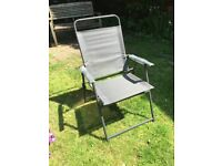 Four fold-up garden chairs brand new