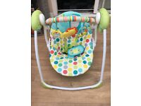 Baby swing and wooden crib