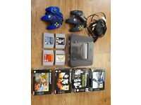 Nintendo 64 console, all leads, 2 controllers and 8 games including Mario Kart and Goldeneye