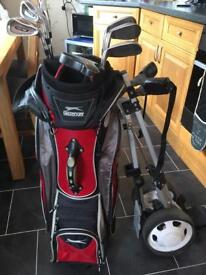 Set of Wilson matrix irons.. bag and pull trolly