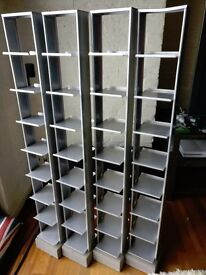Four Ikea CD racks, metal with concrete base, offers considered