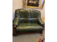 Green leather sofa in fair condition