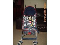 Mickey Mouse pushchair from Mothercare with raincover