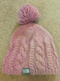 North face pink knit bobble hat with fleece band lining.