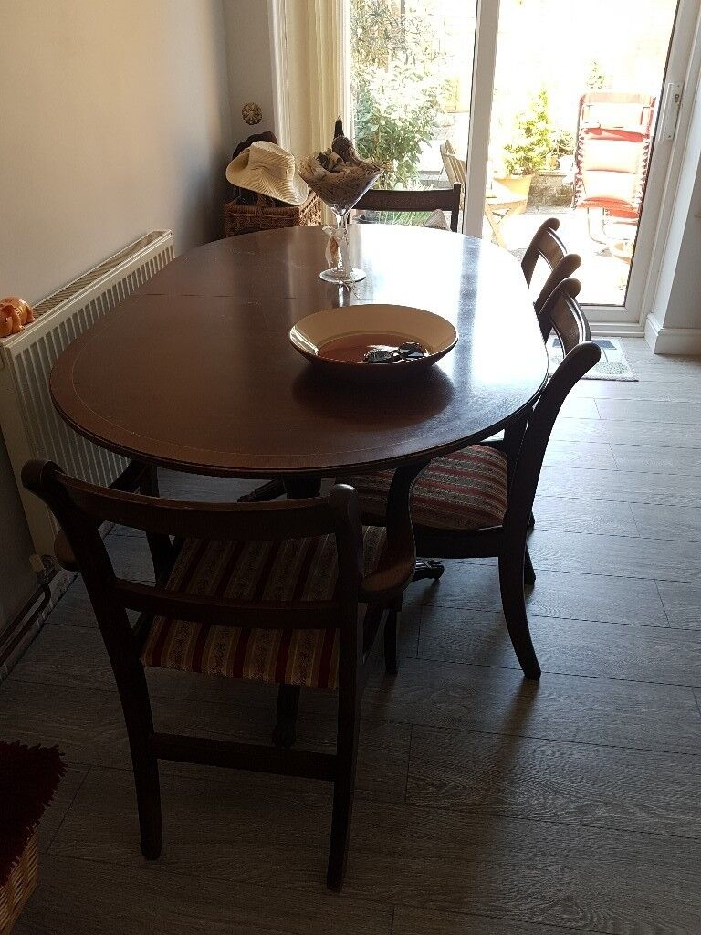 Oval extending table and 6 chairs stripe fabric on chairs castors on table so