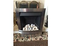 Nearly new modern silver gas fire