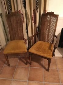 """Four wood upholstered seat dining chairs plus two more """"carvers"""" with arms."""