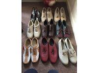 Bundle of flat women shoes.
