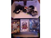 Playstation 2 (PS2) with 2 controllers and 3 games