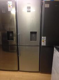 Silver Samsung fridge freezer with waterdispenser
