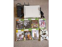 Xbox 360, games and controllers. All cables included