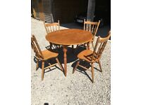Pine round dining with 4 chairs