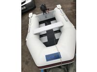SeagoECO260 inflatable with 2.5Hp 4stroke outboard. Suzuki engine and retractable wheels and oars