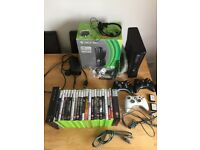 Xbox 360 250GB with built in wifi + 3 controllers + 22 games + gun!