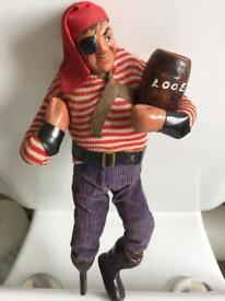 Antique pirate with barrel and wooden leg . ( looe)