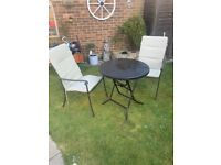 Vintage cast iron fold down bistro table and two chairs