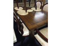 NEVER USED EXTENDABLE DINING TABLE- SOLID WOOD