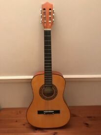 Acoustic guitar and footstool