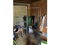 A fully functional Clothing & shoes rolling Rack for sale