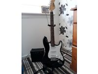 Encore Strat Copy plus practice amp, soft case, and stand.....£70
