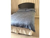 Double bed with black headboard