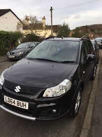 2 year old Suzuki SX4. VGC. Black. VGC.