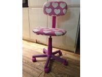 Pink heart swivel chair.