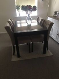 Dark brown and beige buttoned dining table and chairs