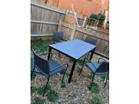 Garden metal table and four matching chairs free delivery